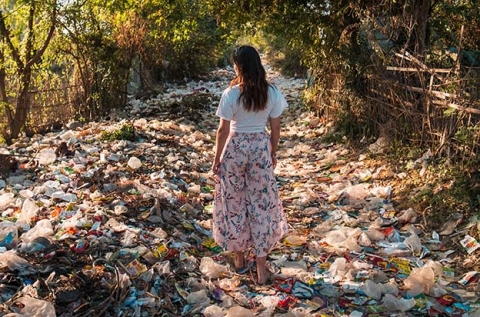 photo-of-a-woman-standing-on-a-pile-of-garbage-near-trees-2583835- big-crop-s - picture by Stijn Dijkstra